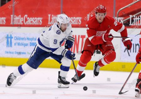 Stock Picture of Tampa Bay Lightning center Tyler Johnson (9) is pursued up the ice by Detroit Red Wings defenseman Dennis Cholowski (21) during the first period of an NHL hockey game, in Detroit