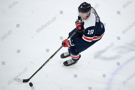 Washington Capitals center Nicklas Backstrom (19) skates with the puck during the third period of an NHL hockey game against the Pittsburgh Penguins, in Washington. The Penguins won 3-0