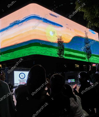 People view a simulated sunrise on an LED screen at the K-pop Square of the COEX convention center in Seoul, South Korea, 02 May 2021. The animated public artwork by British artist David Hockney, 'Remember you cannot look at the sun or death for very long', was commissioned by CIRCA, a London-based platform to showcase digital art in public spaces. The artwork, which carries a message of hope about emerging from pandemic lockdowns, will be shown every evening throughout the month and synchronized with electronic billboards worldwide, including New York's Times Square and Tokyo's Yunika Vision.