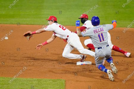Philadelphia Phillies second baseman Nick Maton, left, and shortstop Didi Gregorius, center, reach for a throw from pitcher Zach Eflin as New York Mets' Kevin Pillar slides into second on a run-scoring fielder's choice by James McCann during the sixth inning of baseball game, in Philadelphia. Pillar was safe at second and McCann was safe at first on a throwing error by Eflin