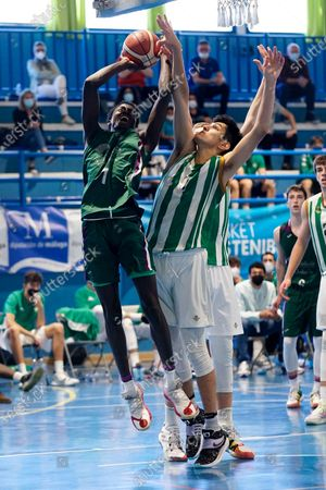 Augusto Daniel Roveres (r) tries to block a shoot of Pierre Sene (l) during the Andalusia Basketball Championship U19 final game between CB Unicaja and Real Betis Baloncesto at Ciudad Deportiva Regino Hernandez in Mijas. (Final score CB Unicaja 82:67 Real Betis Baloncesto)