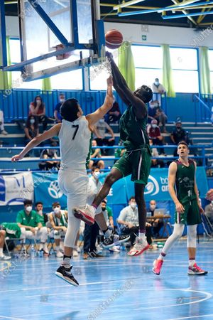 Augusto Daniel Roveres (r) tries to block a dunk of Pierre Sene (l) during the Andalusia Basketball Championship U19 final game between CB Unicaja and Real Betis Baloncesto at Ciudad Deportiva Regino Hernandez in Mijas. (Final score CB Unicaja 82:67 Real Betis Baloncesto)