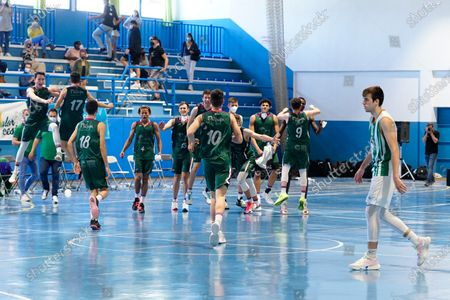 Stock Image of CB Unicaja players seen celebrating the victory of the Andalusia Basketball Championship U19 final game between CB Unicaja and Real Betis Baloncesto at Ciudad Deportiva Regino Hernandez in Mijas. (Final score CB Unicaja 82:67 Real Betis Baloncesto)