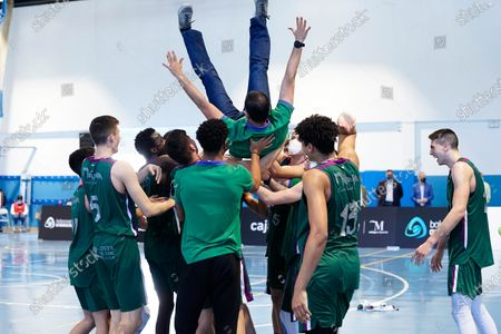 Stock Picture of CB Unicaja players celebrate with coach Antonio Herrera Cabello the victory of the Andalusia Basketball Championship U19 final game between CB Unicaja and Real Betis Baloncesto at Ciudad Deportiva Regino Hernandez in Mijas. (Final score CB Unicaja 82:67 Real Betis Baloncesto)