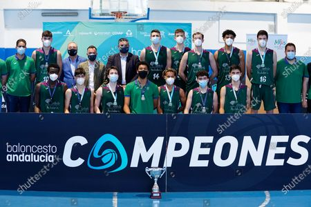 Stock Photo of CB Unicaja players celebrate the victory after the Andalusia Basketball Championship U19 final game between CB Unicaja and Real Betis Baloncesto at Ciudad Deportiva Regino Hernandez in Mijas. (Final score CB Unicaja 82:67 Real Betis Baloncesto)