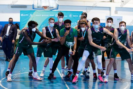 CB Unicaja players celebrate the victory after the Andalusia Basketball Championship U19 final game between CB Unicaja and Real Betis Baloncesto at Ciudad Deportiva Regino Hernandez in Mijas. (Final score CB Unicaja 82:67 Real Betis Baloncesto)