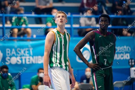 Luis Garcia Perez and Pierre Sene (r) in action during the Andalusia Basketball Championship U19 final game between CB Unicaja and Real Betis Baloncesto at Ciudad Deportiva Regino Hernandez in Mijas. (Final score CB Unicaja 82:67 Real Betis Baloncesto)
