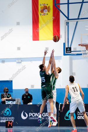 Pablo Leon tries to shoot defended by Luis Garcia Perez during the Andalusia Basketball Championship U19 final game between CB Unicaja and Real Betis Baloncesto at Ciudad Deportiva Regino Hernandez in Mijas. (Final score CB Unicaja 82:67 Real Betis Baloncesto)