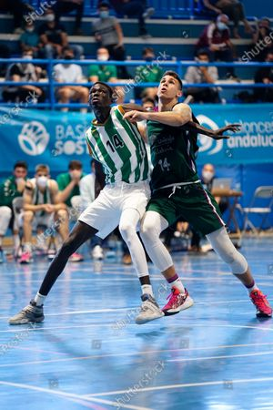 Demba Sheriff (l) fights for a rebound with Daniil Shelist (r) during the Andalusia Basketball Championship U19 final game between CB Unicaja and Real Betis Baloncesto at Ciudad Deportiva Regino Hernandez in Mijas. (Final score CB Unicaja 82:67 Real Betis Baloncesto)