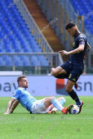 Sergej Milinkovic-Savic Gianluca Scamacca of CFC Genoa during the Serie A League football match between Lazio vs Genoa at Olimpico stadium