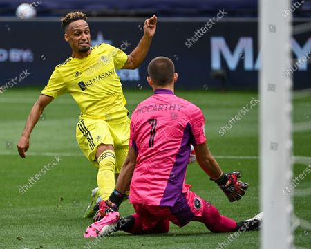 Nashville midfielder, Hany Mukhtar (10), takes a shot on goal, while Inter Miami goalkeeper, John McCarthy (1), attempts to block it, during the MLS match between Inter Miami and Nashville SC at Nissan Stadium in Nashville, TN