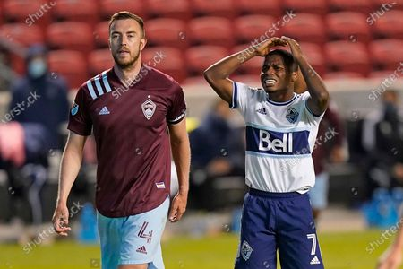 Vancouver Whitecaps forward Deiber Caicedo (7) reacts after missing his shot on goal as Colorado Rapids' Danny Wilson (4) looks on in the second half during an MLS soccer game, in Sandy, Utah