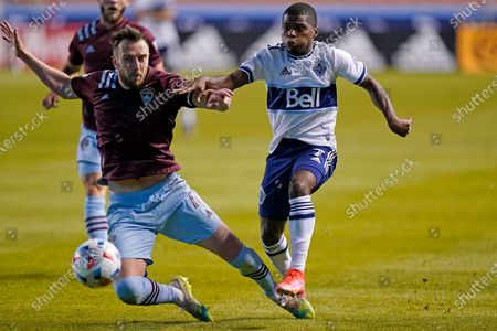 Colorado Rapids defender Danny Wilson, left, defends against Vancouver Whitecaps forward Deiber Caicedo (7) in the second half of an MLS soccer game, in Sandy, Utah