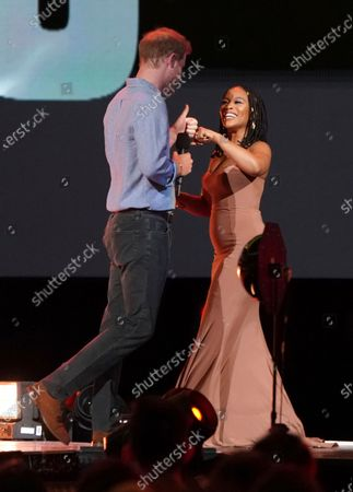 """Prince Harry, Duke of Sussex and Nomzamo Mbatha speak at """"Vax Live: The Concert to Reunite the World"""", at SoFi Stadium in Inglewood, Calif"""