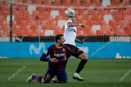 FC Barcelona's defender Clement Lenglet   (L) and Maxi Gomez  of Valencia CF     during  spanish La Liga match between Valencia cf and Futbol Club Barcelona  at Mestalla Stadium on May  2, 2021 in Valencia, Spain.