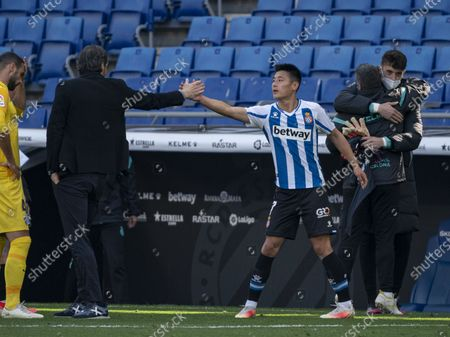 (210503) - CORNELLA, May 3, 2021 (Xinhua) - RCD Espanyol's Wu Lei (R, front) celebrates with head coach Vicente Moreno after a Spanish second division league football match between RCD Espanyol and Malaga CF in Cornella, Spain, May 2, 2021.