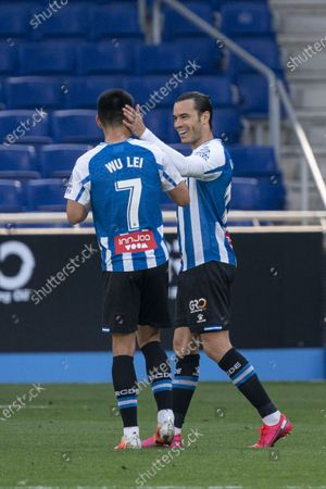 Stock Image of (210503) - CORNELLA, May 3, 2021 (Xinhua) - RCD Espanyol's Wu Lei (L) celebrates with Raul de Tomas during a Spanish division league football match between RCD Espanyol and Malaga CF in Cornella, Spain, May 2, 2021.