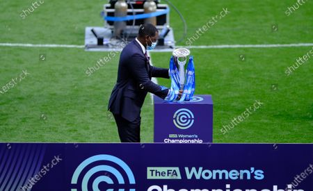Stock Image of Emile Heskey with the championship trophy
