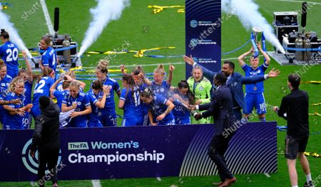 Emile Heskey showers the Leicester players with champagne During the FA Womens Championship game between Leicester City and Charlton Athletic at King Power Stadium in Leicester, England