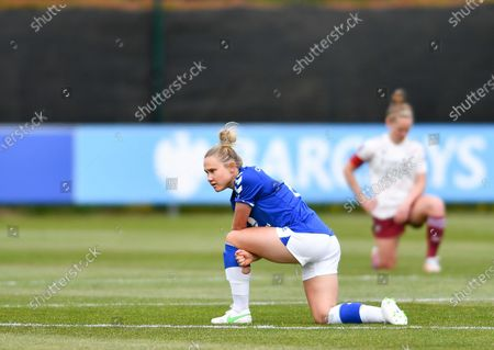 Izzy Christiansen (8 Everton) kneels prior to the Barclays FA Womens Super League game between Everton and Arsenal at Walton Hall Park in Liverpool, England.