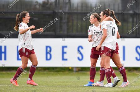 Katie McCabe (15 Arsenal) celebrates scoring her sides first goal with team mates