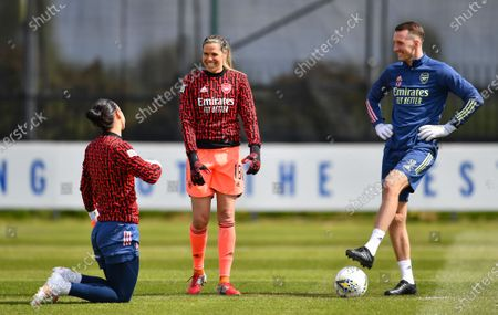 Manuela Zinsberger (1 Arsenal) and Lydia Williams (18 Arsenal) share a joke with a team assistant prior to the Barclays FA Womens Super League game between Everton and Arsenal at Walton Hall Park in Liverpool, England.