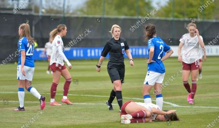 Stock Image of Katie McCabe (15 Arsenal) is injured in the penalty box