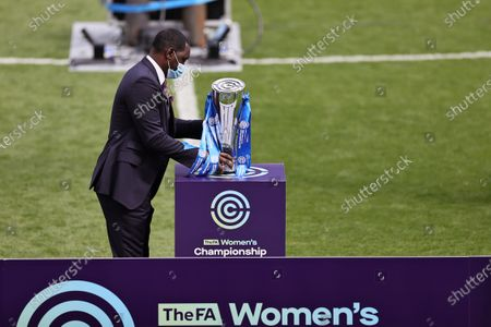 Emile Heskey places the womens Championship trophy on the stand after the FA Women's Championship match between Leicester City and Charlton Athletic at the King Power Stadium, Leicester on Sunday 2nd May 2021.