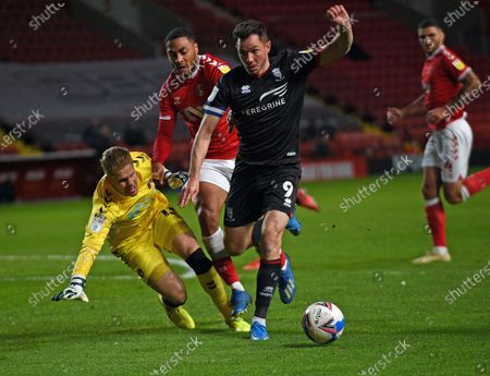Tom Hopper takes on the Charlton defence but the effort saved by keeper Alex Palmer of Lincoln City; The Valley, London, England; English Football League One Football, Charlton Athletic versus Lincoln City.