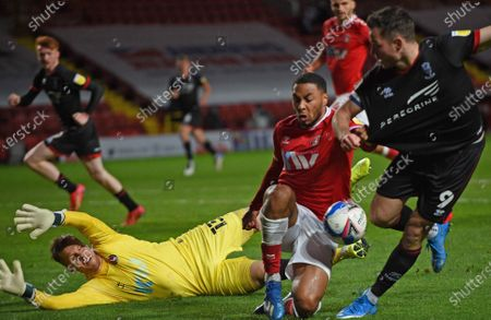 Stock Image of Tom Hopper takes on the Charlton defence but the effort saved by keeper Alex Palmer of Lincoln City; The Valley, London, England; English Football League One Football, Charlton Athletic versus Lincoln City.