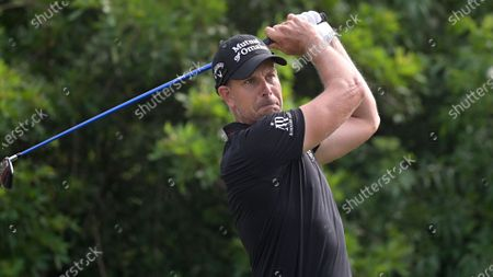 Stock Photo of Henrik Stenson, of Sweden, watches his tee shot on the seventh hole during the final round of the Valspar Championship golf tournament, in Palm Harbor, Fla