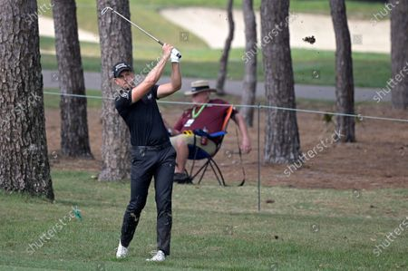 Henrik Stenson, of Sweden, hits from the sixth fairway during the final round of the Valspar Championship golf tournament, in Palm Harbor, Fla