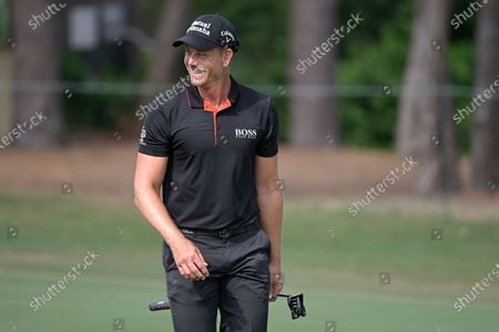 Henrik Stenson, of Sweden, laughs while walking on the sixth fairway during the final round of the Valspar Championship golf tournament, in Palm Harbor, Fla