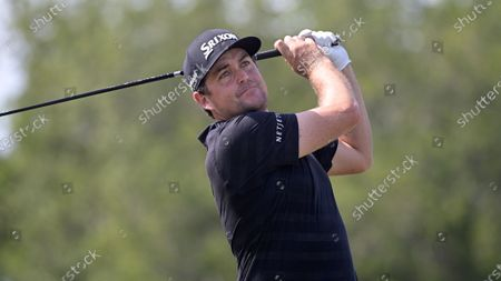 Keegan Bradley watches his tee shot on the 10th hole during the final round of the Valspar Championship golf tournament, in Palm Harbor, Fla