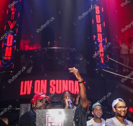 (L-R) DJ Stevie J and Travis Scott at LIV nightclub at Fontainebleau Miami Beach, Florida.