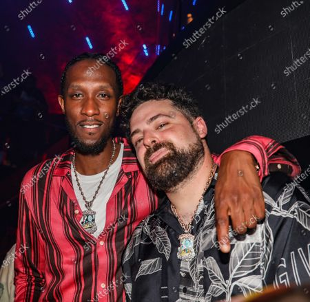 (L-R) Bizzy and David at LIV nightclub at Fontainebleau Miami Beach, Florida.
