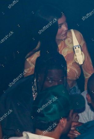 (L-R) Travis Scott and Kylie Jenner at LIV nightclub at Fontainebleau Miami Beach, Florida.