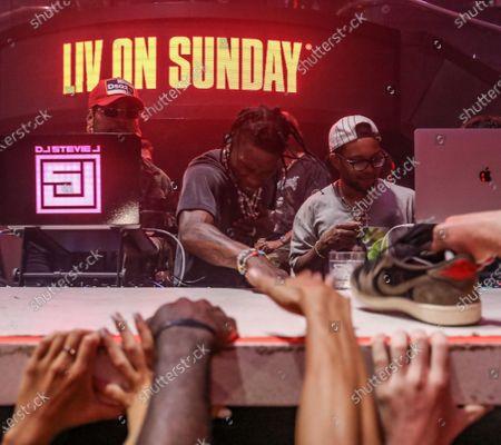 (L-R) DJ Stevie J, Travis Scott and CHASE B at LIV nightclub at Fontainebleau Miami Beach, Florida.
