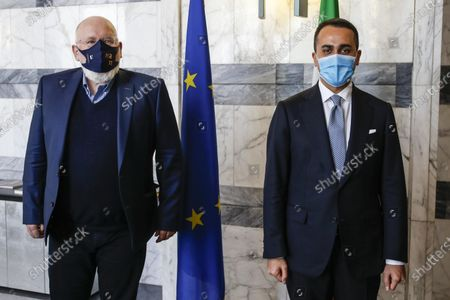 Italian Foreign Minister Luigi Di Maio (R) and Vice President of the European Commission, Frans Timmermans (L), pose for a photograph prior to a bilateral meeting in Rome, Italy, 03 May 2021.