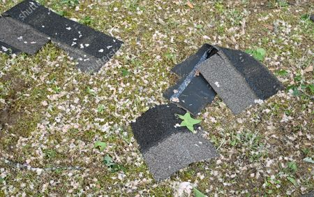 Stock Image of Shingles and insulation cover the ground on Elvis Presley Drive in Tupelo, Miss., . Multiple tornadoes were reported across the state on Sunday