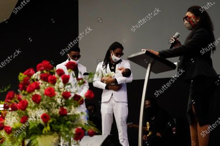 Bridgett Floyd, the sister of George Floyd, speaks during a funeral for Andrew Brown Jr., at Fountain of Life Church in Elizabeth City, N.C. Brown was fatally shot by Pasquotank County Sheriff deputies trying to serve a search warrant. Andrew Brown Jr.'s sons Jha'rod Ferebee, left, and Khalil Ferebee stand on the stage