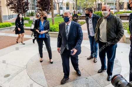 Phil Schiller, an Apple executive, enters the Ronald V. Dellums building in Oakland, Calif.,, to attend a federal court case brought by Epic Games. Epic, maker of the video game Fortnite, charges that Apple has transformed its App Store into an illegal monopoly