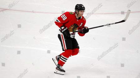 Chicago Blackhawks right wing Patrick Kane (88) makes a pass during an NHL hockey game, in Chicago