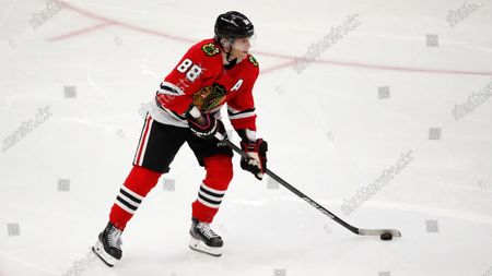 Chicago Blackhawks right wing Patrick Kane (88) handles the puck during an NHL hockey game, in Chicago