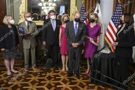 U.S. Vice President Kamala Harris, right, listens as Bill Nelson, former Democratic Senator from Florida and administrator of the National Aeronautics and Space Administration (NASA), second from right, speaks, following a swearing in ceremony. Alongside Nelson, from left, current nominee for Deputy NASA Administrator Pam Melroy, former NASA Administrator under Obama-Biden Charlie Bolden, his son Bill Nelson Jr., his daughter Nan Ellen Nelson, former NASA Administrator Jim Bridenstine, virtual from a laptop, and his wife, Grace Nelson holding the bible, in the Eisenhower Executive Office Building in Washington, D.C., USA, 03 May 2021. The Senate confirmed Nelson on April 29 to be the agency's new administrator.