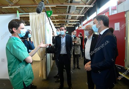 Gent mayor Mathias De Clercq and Prime Minister Alexander De Croo pictured during a visit to the the vaccination center at Flanders Expo in Gent, Monday 03 May 2021.