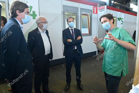 Gent mayor Mathias De Clercq (L) and Prime Minister Alexander De Croo (2R) pictured during a visit to the the vaccination center at Flanders Expo in Gent, Monday 03 May 2021.