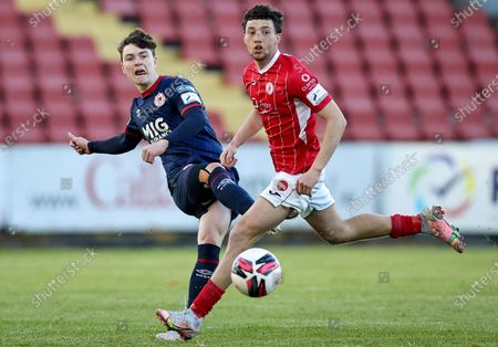 Sligo Rovers vs St. Patrick's Athletic. St Patricks' Alfie Lewis with Jordan Gibson of Sligo Rovers