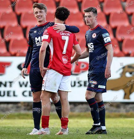 Sligo Rovers vs St. Patrick's Athletic. St Patricks' Chris Forrester with Jordan Gibson of Sligo Rovers at the full time whistle