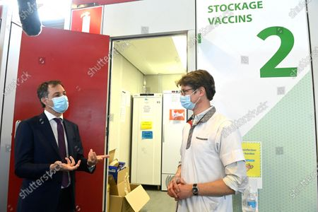 Belgium Prime Minister Alexander De Croo (L) visits at Covid-19 vaccination center at Flanders Expo, in Gent, Belgium, 03 May 2021. During his working visit to the Gent vaccination center, Alexander De Croo, accompanied by Mayor Mathias De Clercq, will be briefed on the logistical approach to the Covid-19 vaccination. He will also get an overview of the new phase of the vaccination plan that Belgium is entering, with the expected delivery of more than eight million vaccine doses in May and June 2021.
